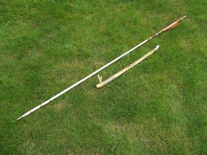 a homemade atlatl lying on the ground